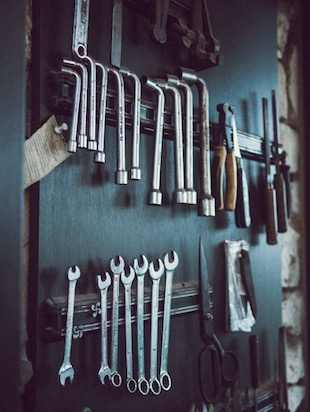 Image of hand wrenches on a tool rack